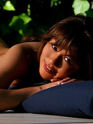Charmane Star is a tanned Asian beauty in a..