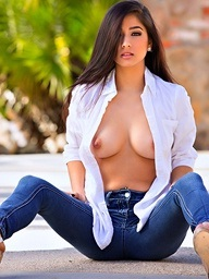 Megan Salinas rips retire from her shirt..