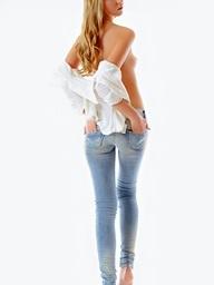 Honey unbuttons her jeans